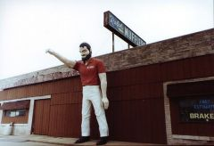 Old US 52/136: Mr. Bendo stands guard outside local muffler