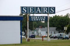 Old US 421: An old Sears sign that hangs on.