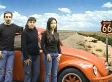 Trio of Student designers with car on Route 66