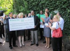 W3 Staff Receive check for development of Woodward Ave. Tributes