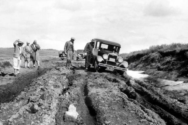 A pioneering car stuck on the Yellowstone Trail.