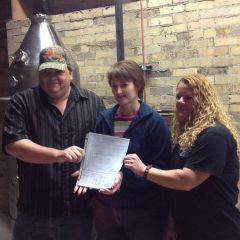 Doug Nutter and friends display their Liquor Distilling licence