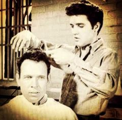 Elvis giving a trim in a movie