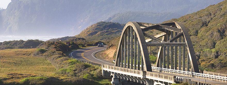 Car Driving On A Bridge
