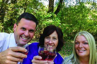 Three People Drinking Wine