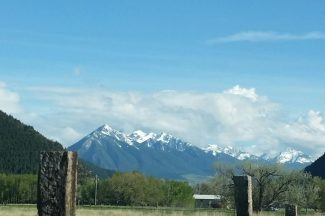 Fence Post And Mountains In Montana